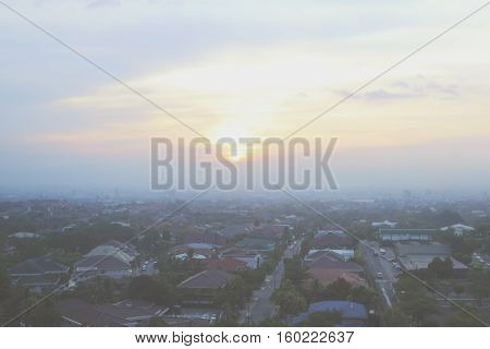 Misty, foggy urban suburb background. View from above on the residential area of the Manila city at sunset - Manila, Philippines
