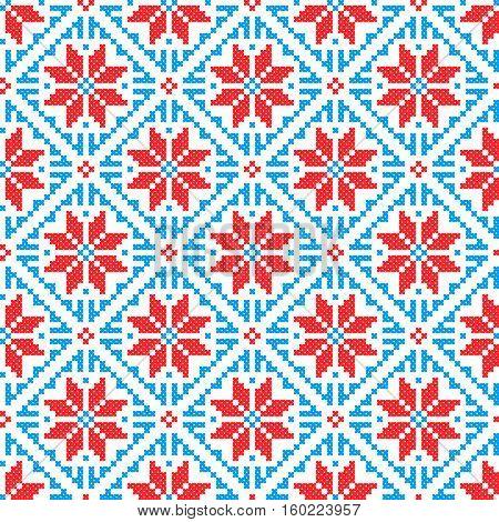 Embroidered old handmade cross-stitch ethnic Ukrainian pattern. Seamless winter ornament