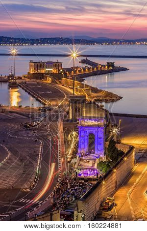 ANCONA ITALY - SEPTEMBER 3 2016: Industrial commercial port at sunset Ancona Italy. View from the hill