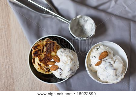 homemade ice cream with a spoon and sweet cheese cake dessert