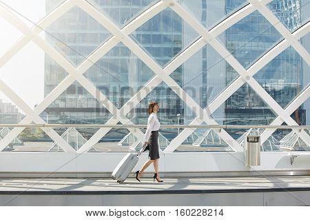 Traveling Business Woman Walking With Suitcase In Terminal