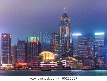 Hong Kong, Special Administrative Region of the People's Republic of China - 20 April 2016: central quay glowing at night during laser show from Victoria's harbour