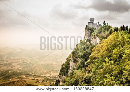 Beautiful panoramic view of the medieval fortress De La Fratta or Cesta overlooking the green hills of San Marino republic - an enclaved microstate surrounded by Italy. San Marino is the oldest sovereign state and constitutional republic in the world.