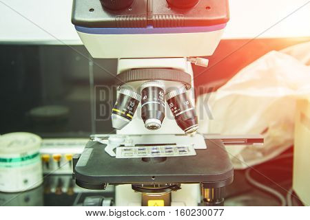 microscope for medical sample in labalotomy room selective focus lens and flare