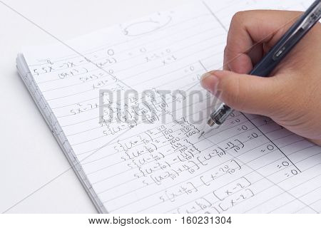 Doing difficult math homework / Solving Exponential Equations