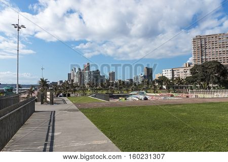 Grass Verge Against City Skyline In Durban South Africa