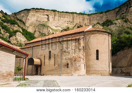 Mtskheta, Georgia. The Upper Church Of Holy Virgin Or Theotokos, Central Part Of Medieval Monastic Shio-Mgvime Complex In Limestone Canyon In Sunny Spring Summer.