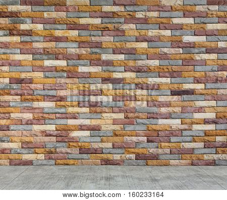 multi color brick wall and cement floor
