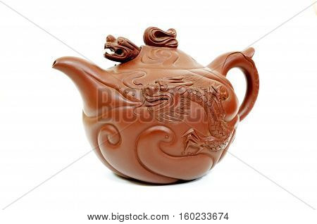 Dragon shaped traditional chinese teapot on a white background