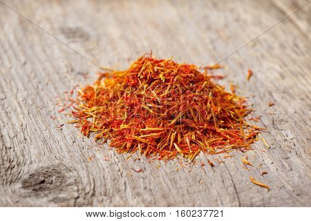 pile of saffron on the old wooden background