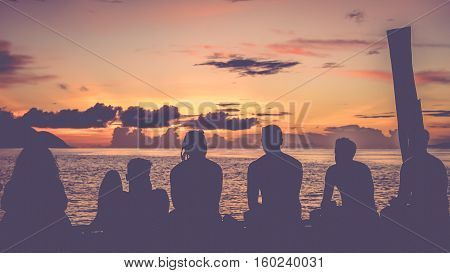 Travelers, Divers chilling at the Pier on Sunset, Kri Island. Raja Ampat, Indonesia, West Papua.