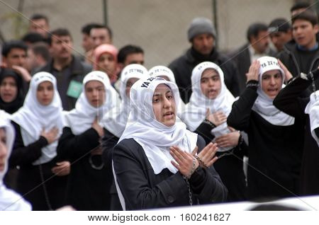 ISTANBUL, TURKEY - MARCH 13: Shiite mourners offer afternoon payer during Chehlum Procession of Hazrat Imam Hussain (AS) on March 13, 2003, in Istanbul,Turkey.