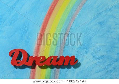 Red letters spelling the word dream to illustrate the concept of inspiration ambition and motivation; landscape orientation.