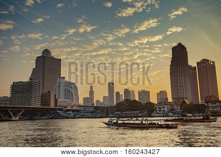 BANGKOK THAILAND - JANUARY 14 : beautiful scenic of chaopraya river and water traffic in heart of thailand capital on january 14 2015 in bangkok thailand