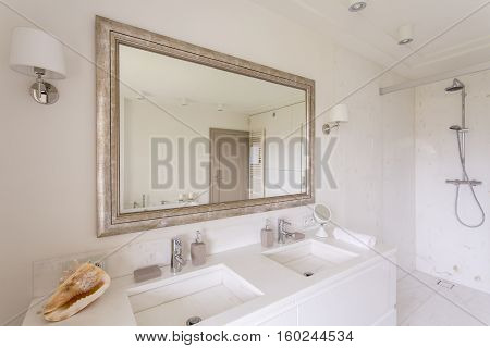 Minimalist Bathroom With Large Mirror