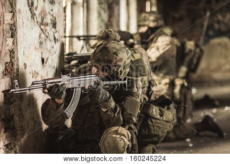 Young Army Soldiers With Weapon
