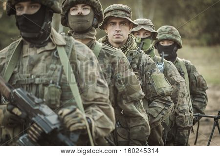 Armed Young Masked Soldiers