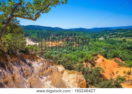 The pit on production ochre. Languedoc - Roussillon, France. Orange picturesque hills