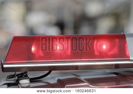 Red flashing sirens of police car during driving