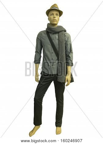 Full length male mannequin dressed in gray shirt and trousers isolated on white background. No brand names or copyright objects.