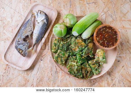 Fried mackerel with shrimp paste sauce cha-om kai and vegetable set. Thai food