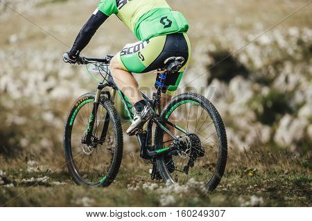 Privetnoye Russia - September 21 2016: closeup of a male rider and sports mountain bicycle during Crimean race mountainbike