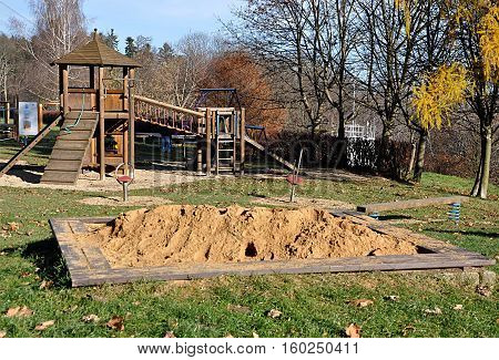 view of the sandbox and playground in a day