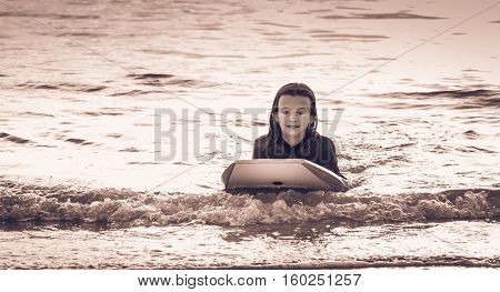 Girl Dressed With A Wetsuit With A Bodyboard