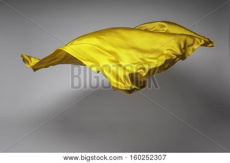 yellow flying fabric - art object, design element
