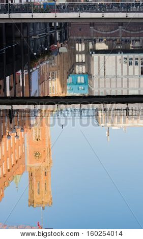 Building reflexion in the water at the Pale footbridge in Hamburg