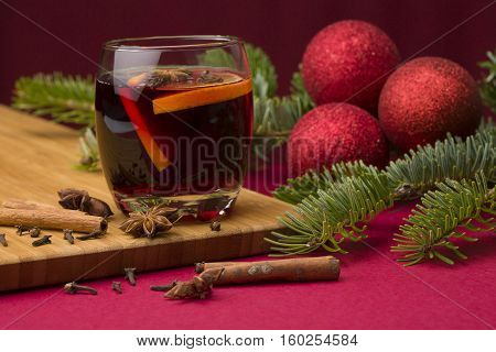 Christmas mulled wine with fire tree over red background