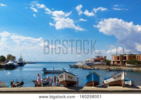 NESEBAR BULGARIA SEPTEMBER 06 2013: Fishing boats at the pier in the harbor of the old town of Nessebar Bulgaria. Clear sunny summer day on the Bulgarian Black Sea Coast.