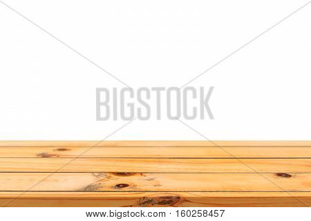 Empty light wooden board table top isolated on white background. Perspective brown wood table isolated on background - can be used mock up for display or montage your products or design visual layout.