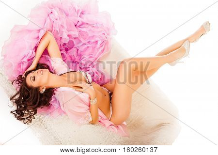 Young attractive woman dreaming on a pink cape