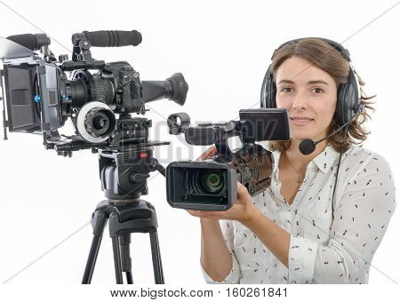 pretty young girl with a professional camcorder on white
