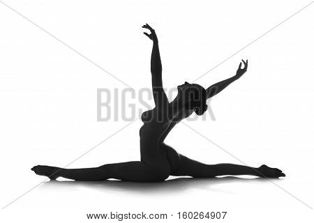 Nude yoga artistic photos of beautiful sexy body of young woman with perfect figure on splits isolated on white background studio shot