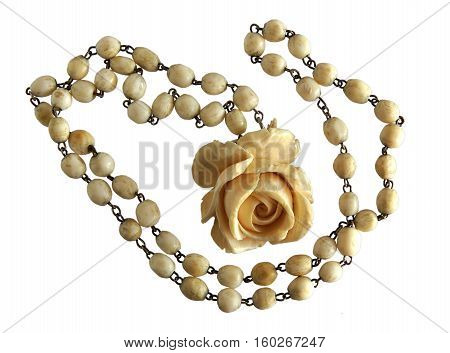 Vintage Elephant Ivory Necklace and Exquisite Carved Rose Pendant isolated on white background