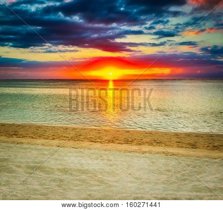White sandy beach Le Morn  at sunset. Mauritius.