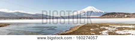 Winter Mount Fuji at Iced Yamanaka Lake in snow winter season Japan Panoramic