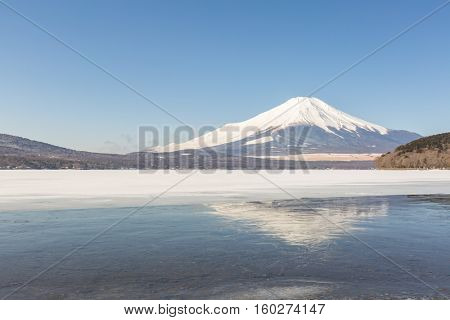 Reflection of Winter Mount Fuji at Iced Yamanaka Lake in snow winter season Japan