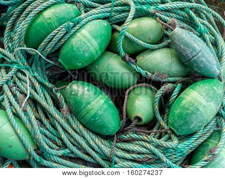 LUARCA SPAIN - DECEMBER 4 2016: Green fishing gear at the fish market pier in Luarca Spain.