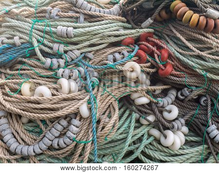 LUARCA SPAIN - DECEMBER 4 2016: Colorful ropesfloats and sinkers at the fish market pier in Luarca Spain.