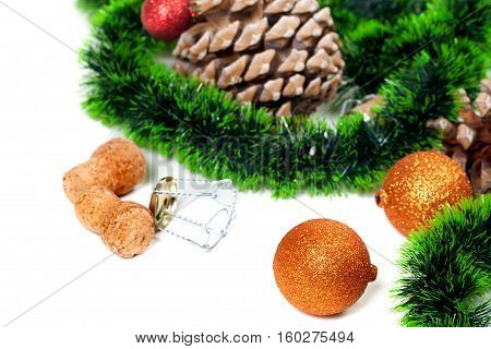 Christmas Tinsel, Christmas-tree Balls, Pine Cones And Champagne Wine Cork With Muselet