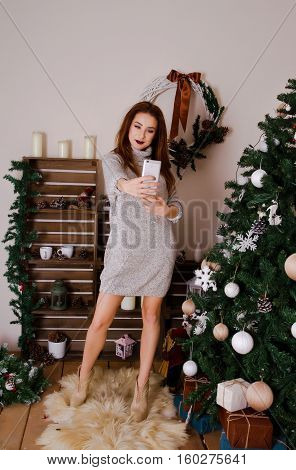 Young girl is photographed on a background of trees dressed up