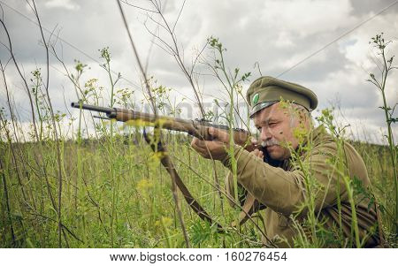 POKROVSKOE SVERDLOVSK OBLAST RUSSIA - JULY 17 2016: Historical reenactment of Russian Civil war in the Urals in 1919. Soldier Of The White Army