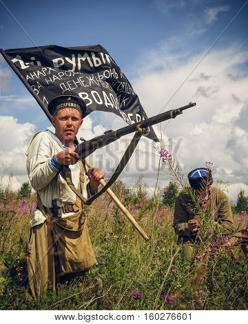 POKROVSKOE SVERDLOVSK OBLAST RUSSIA - JULY 17 2016: Historical reenactment of Russian Civil war in the Urals in 1919. Soldier-anarchist