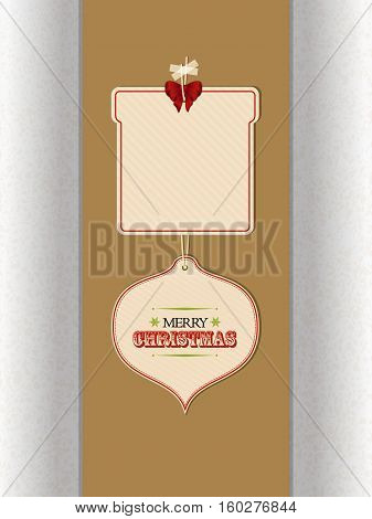 Two Christmas Gift Tags in Cardboard with Merry Christmas Text and Copy Space Hanging with Sellotape Over Brown Panel with Shadows