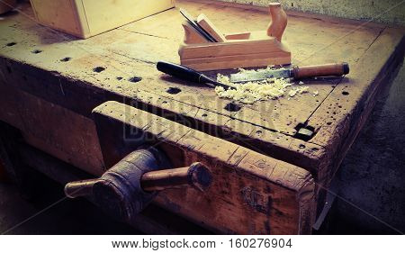 planer and bitten in the ancient workshop of the carpenter