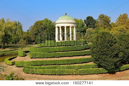 ancient monopteros with the dome in classic style over the public park hill