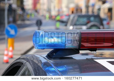 Police Car With Red And Blue Sirens In The Checkpoint